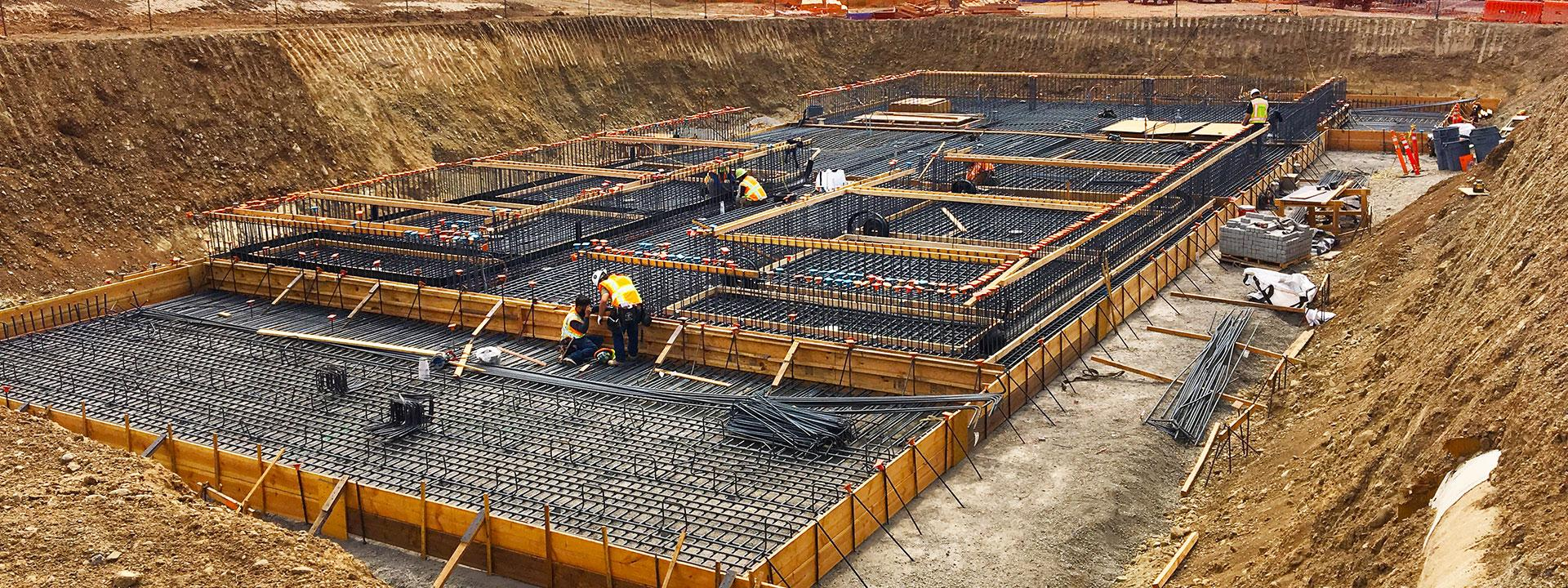 Large dig site with base being built for construction